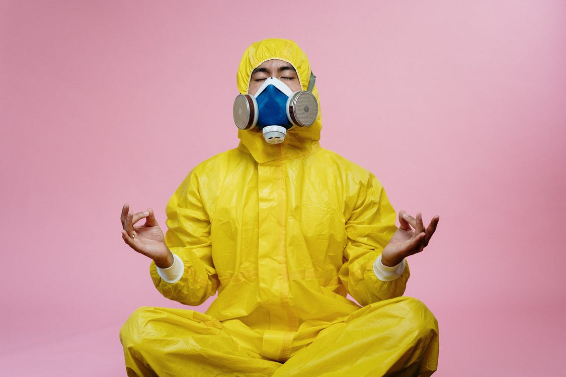 A pest control worker, wearing proper safety equipment